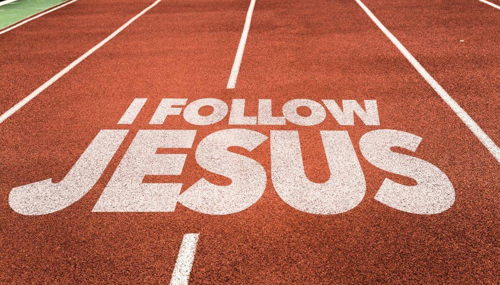 I Follow Jesus written on running track